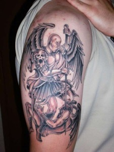 Arch angel fighting demon tattoo.