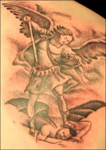 Angel stepping on Satan's head tattoo.