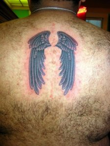 Angel wings cross tattoo on upper arm and angel wings cross tattoo on upper