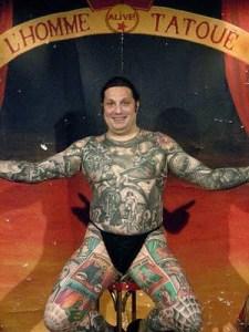 Body Art Tattoo Comic story tattooed on fat man's body .
