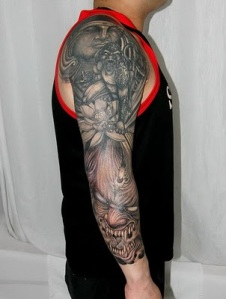 buddha and devil tattoo on the arm