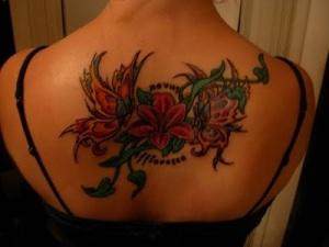 Labels: back flower tattoo design