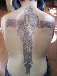The origin of the Celtic cross tattoo designs has been lost in history.