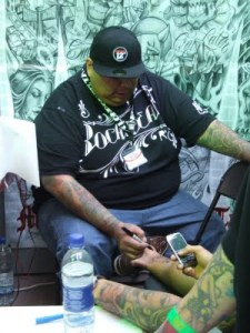 Boog Here's a few shots of various tattooists working on their ...