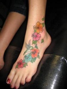 Flowers Tattoo With Hummingbird Tattoo