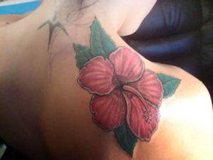 The most common flowre in hawaiian flower tattoo designs, textile and art