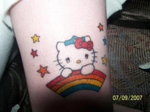 Have a look at these pictures of people with delightful rainbow tattoos.
