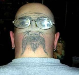 Glasses Tattoo Back Head Biker Earrings. via weirdthings