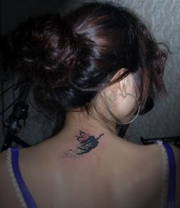 What a nice dark angel tattoo, a torn wing, inked on the shoulder in black!