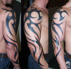 Tribal tattoos design for men on arm with many type style.