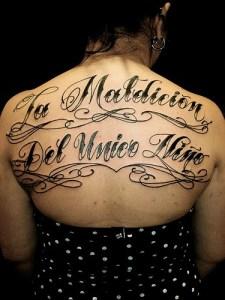 back lettering tattoos girl