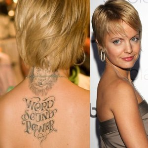 She also has tribal tattoos on the small of her back and a tattoo on her