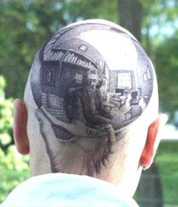 Feast your eyes on some freaky head tattoos.