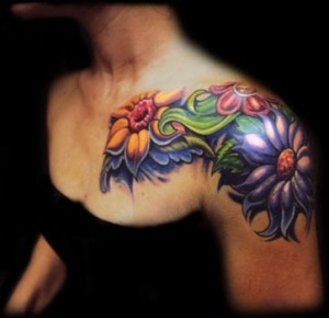 Yellow green and purple flowers shoulder tattoo.