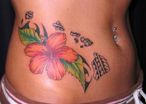 Flower stomach tattoo.