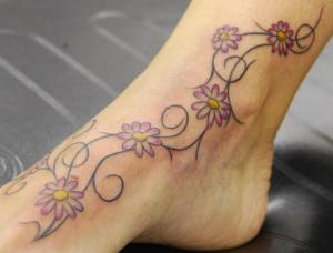 Flower and vine tattoo.