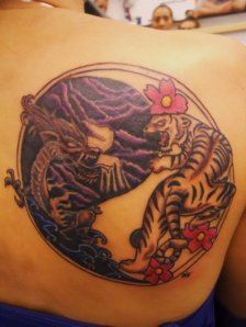 Tribal yin yang tattoo design on back left shoulder.